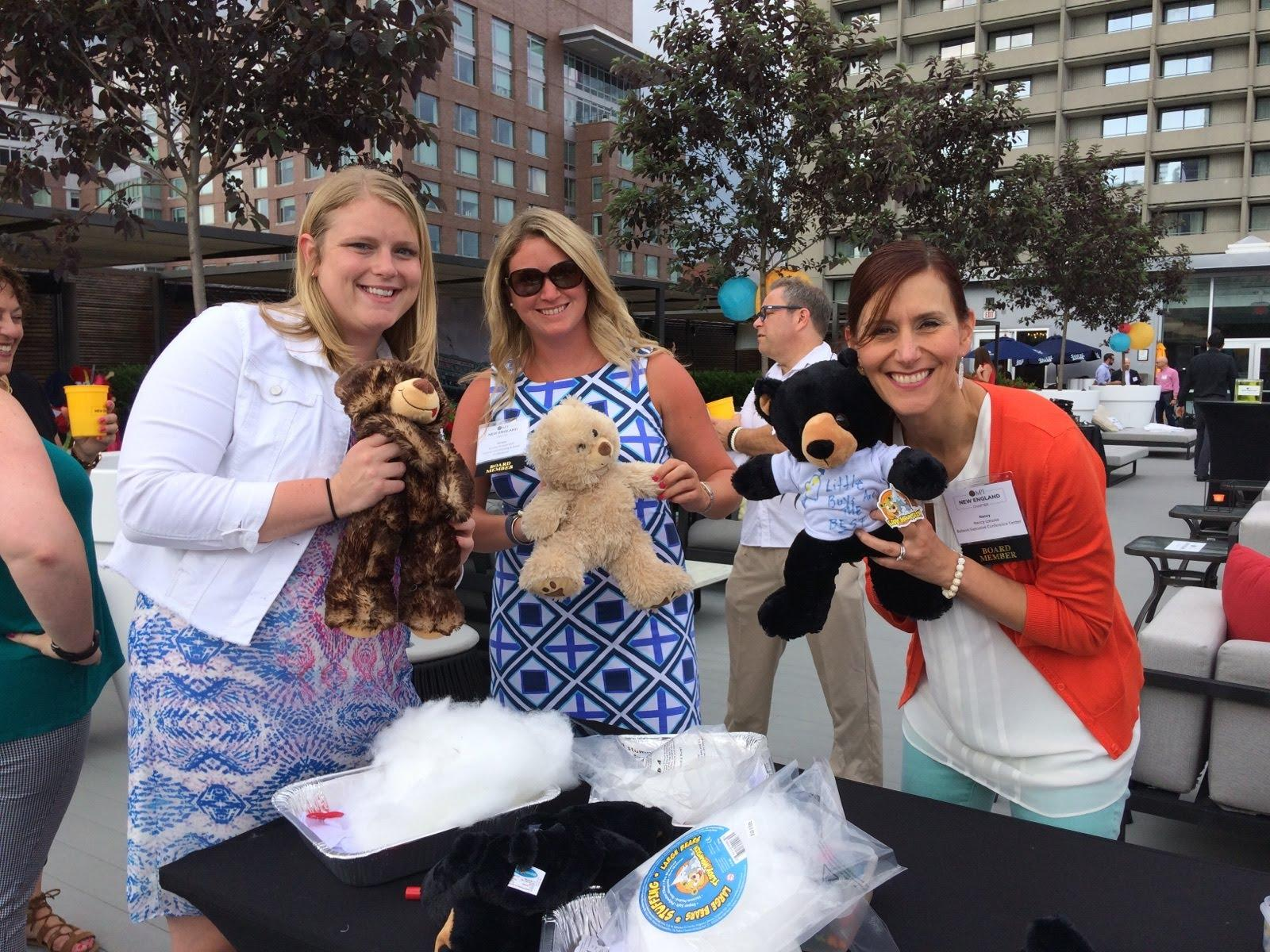 Employees making stuffed animals for children