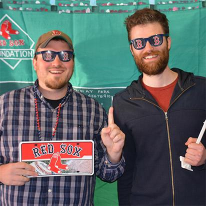 employees with Boston Red Sox props taking a Party Portrait